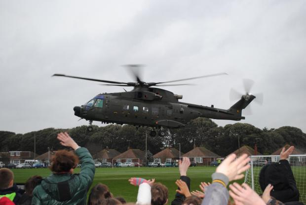 The Argus: Children wave at Mr Rudd in his helicopter