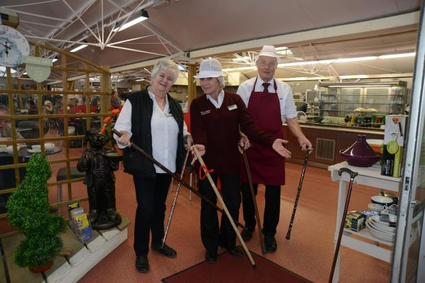 The Argus: Staff members Pam, Karin and David with some of the walking sticks