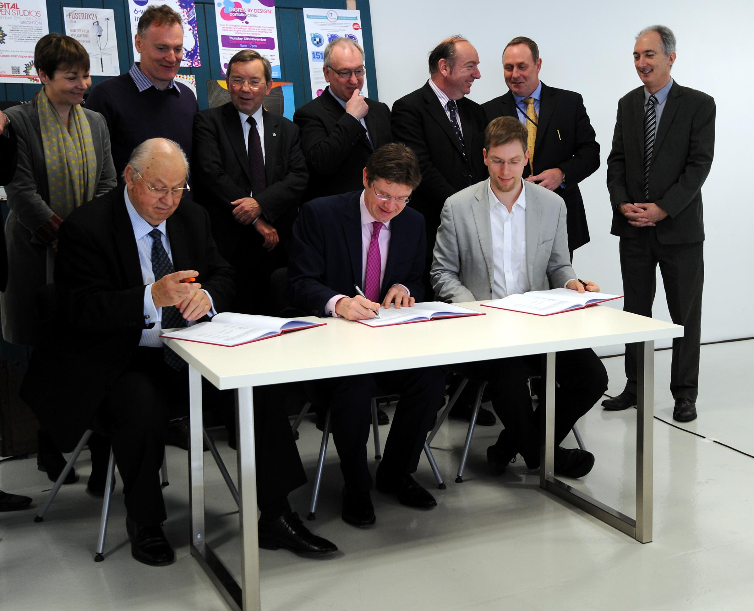 Signing of the City Deal - Minister for Cities Greg Clark (seated centre) with Brighton council leader Jason kitcat (right) and John Peel chair of the coast to capital local enterprise partnership (left) in the front row
