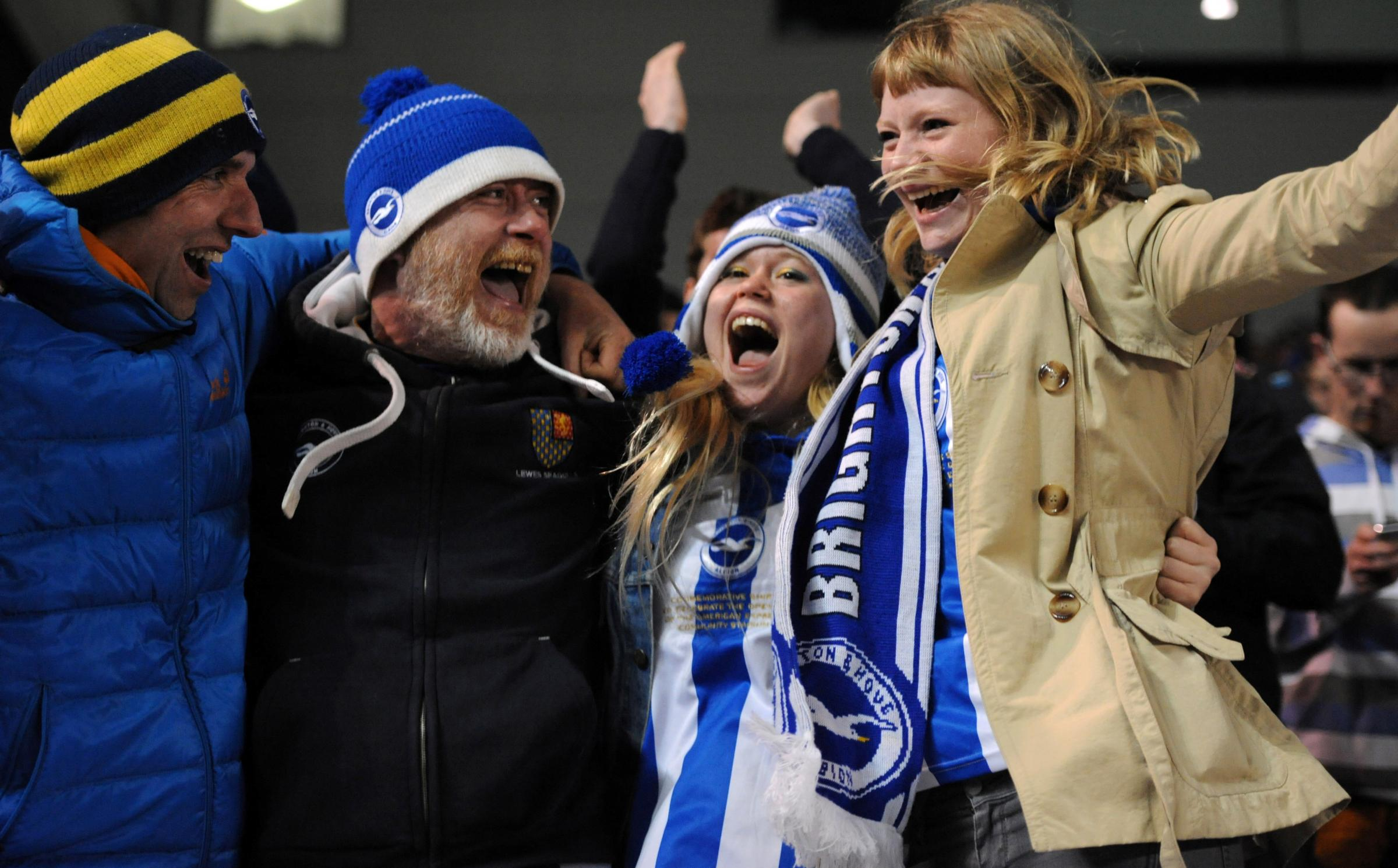 Albion fans celebrate at the Amex last night