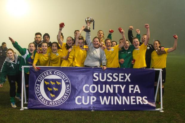 The Argus: Chichester City celebrate their win. Picture by Geoff Penn