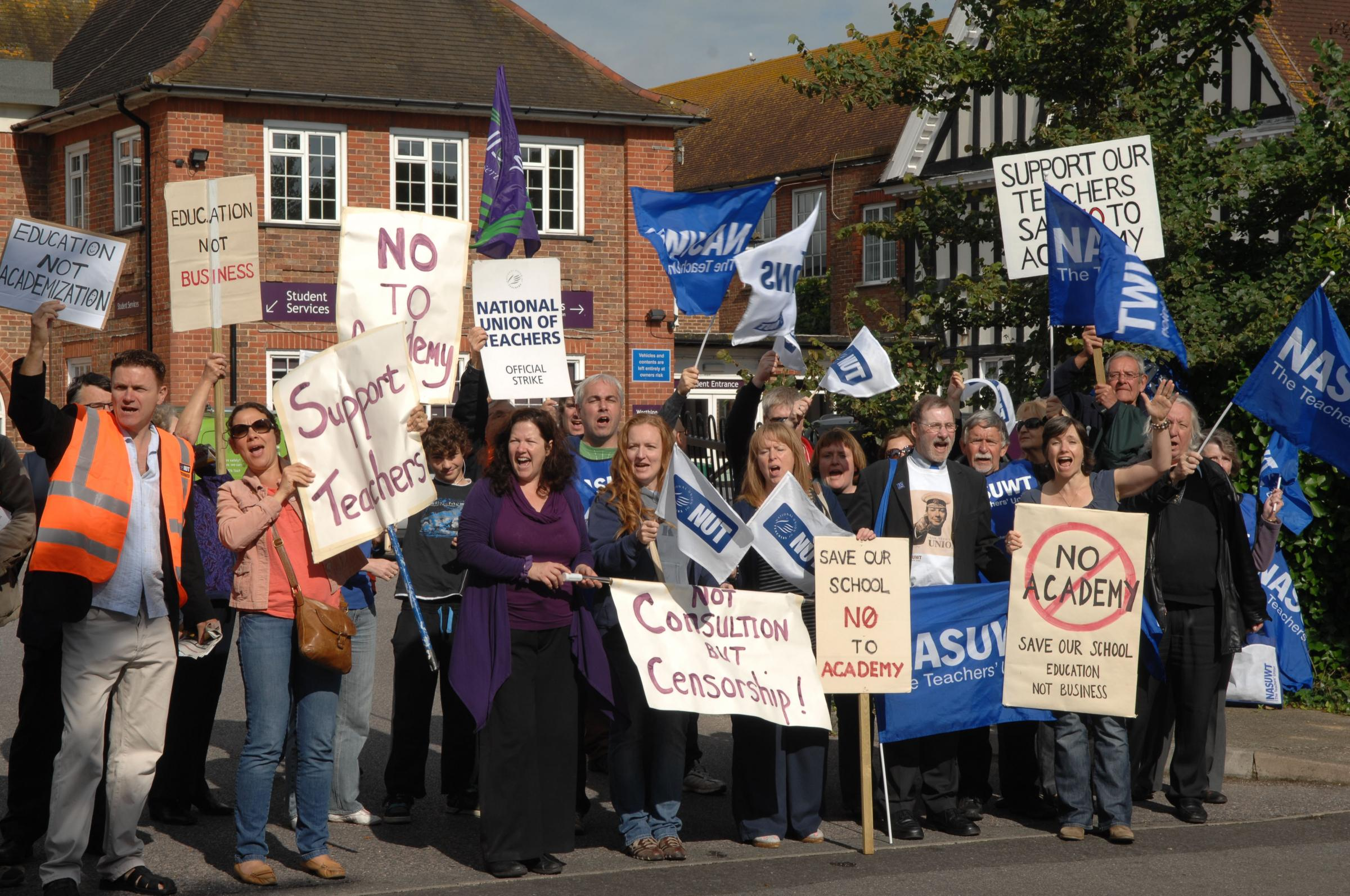 Teachers and unions picket the entrance to Worthing High School to protest against plans for conversion to an academy