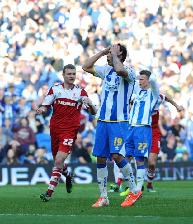 The Argus: Leo Ulloa reacts after missing the penalty (photo Simon Dack)
