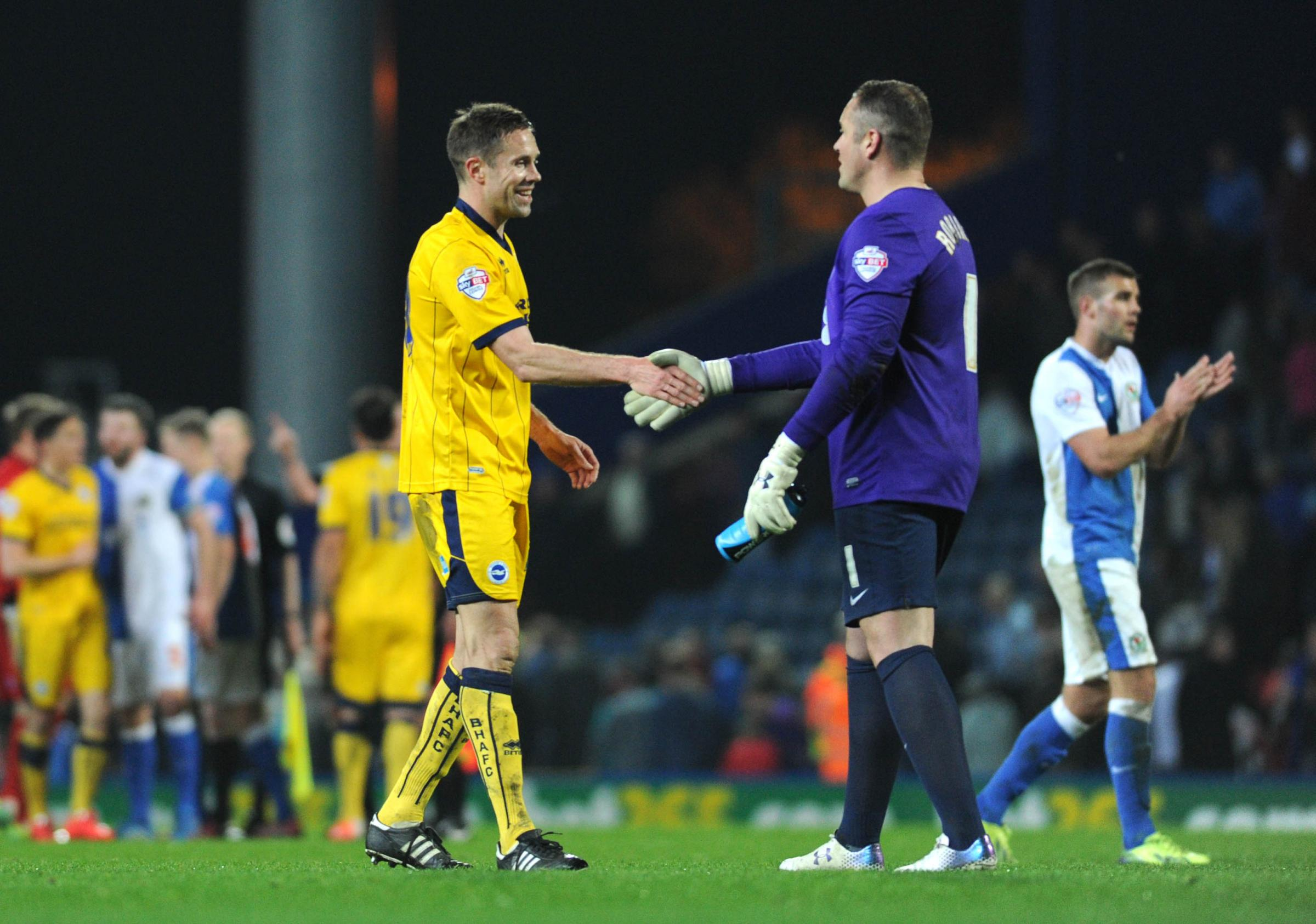 Matt Upson shakes hands with Paul Robinson after Albion snatched a confidence boosting point at Blackburn