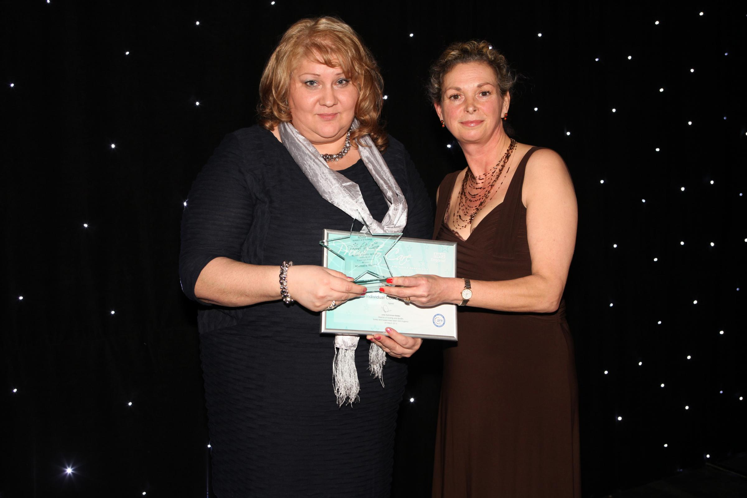 Ward sister Michelle Harris, who works at St Richard's Hospital in Chichester, collecting her award