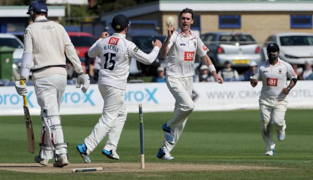 The Argus: Steve Magoffin celebrates the wicket of Toby Roland-Jones