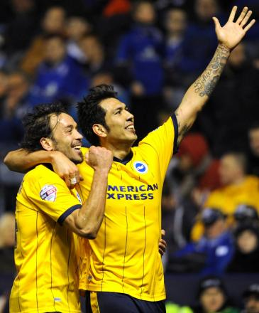 Leo Ulloa celebrates one of his two goals at Leicester in April