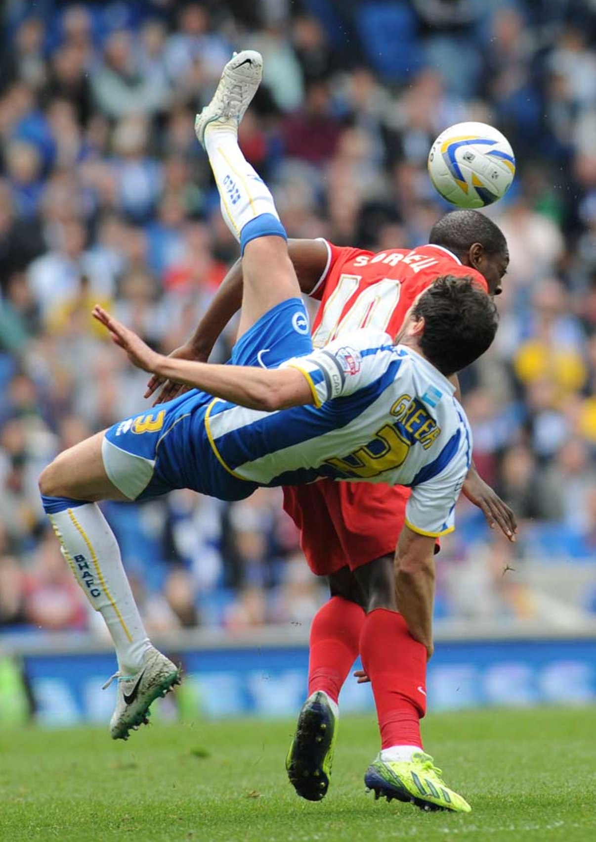 Gordon Greer tangles with Charlton striker Marvin Sordell