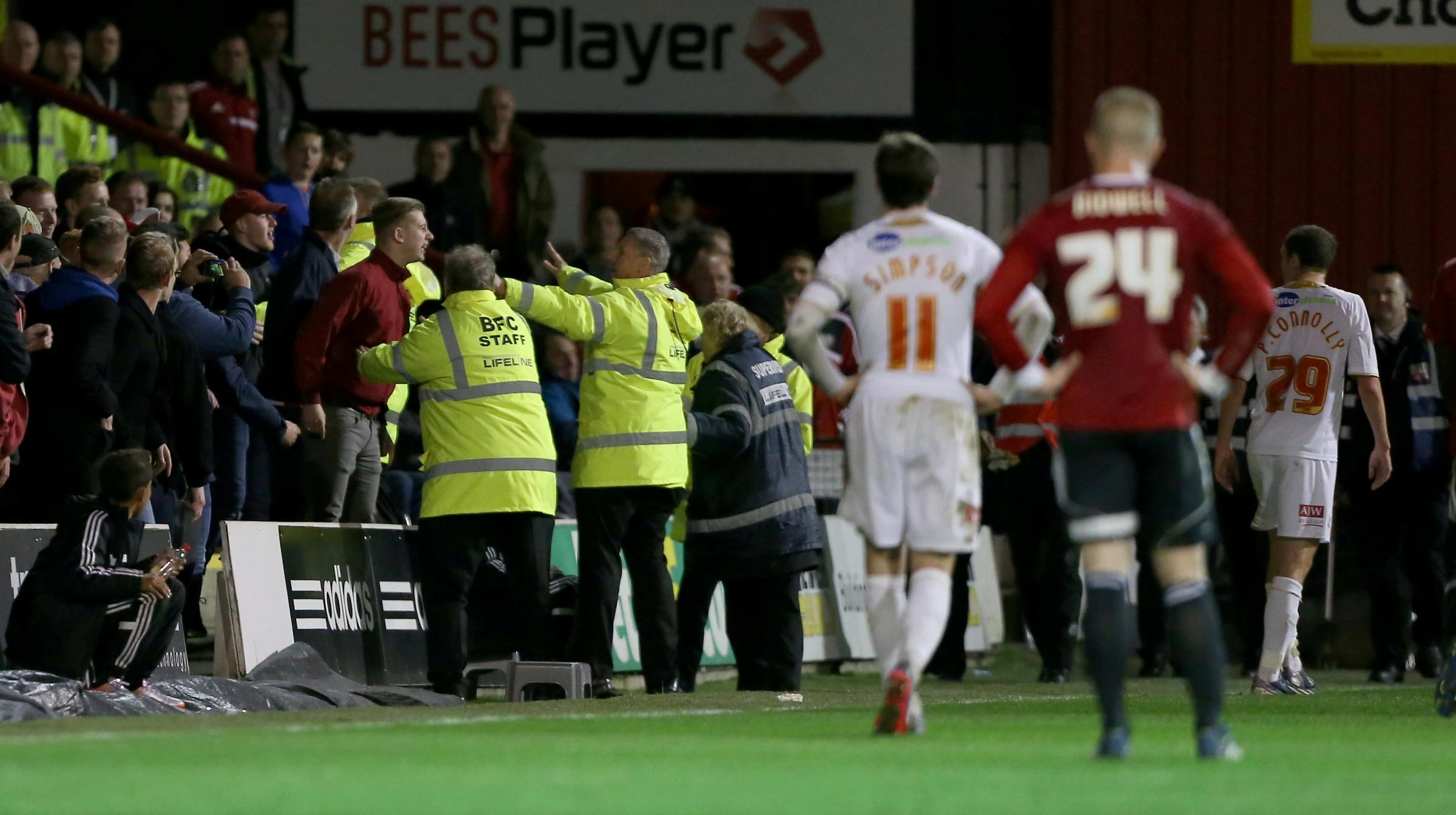 Paul Connolly, far right, walks away from the incident at Griffin Park