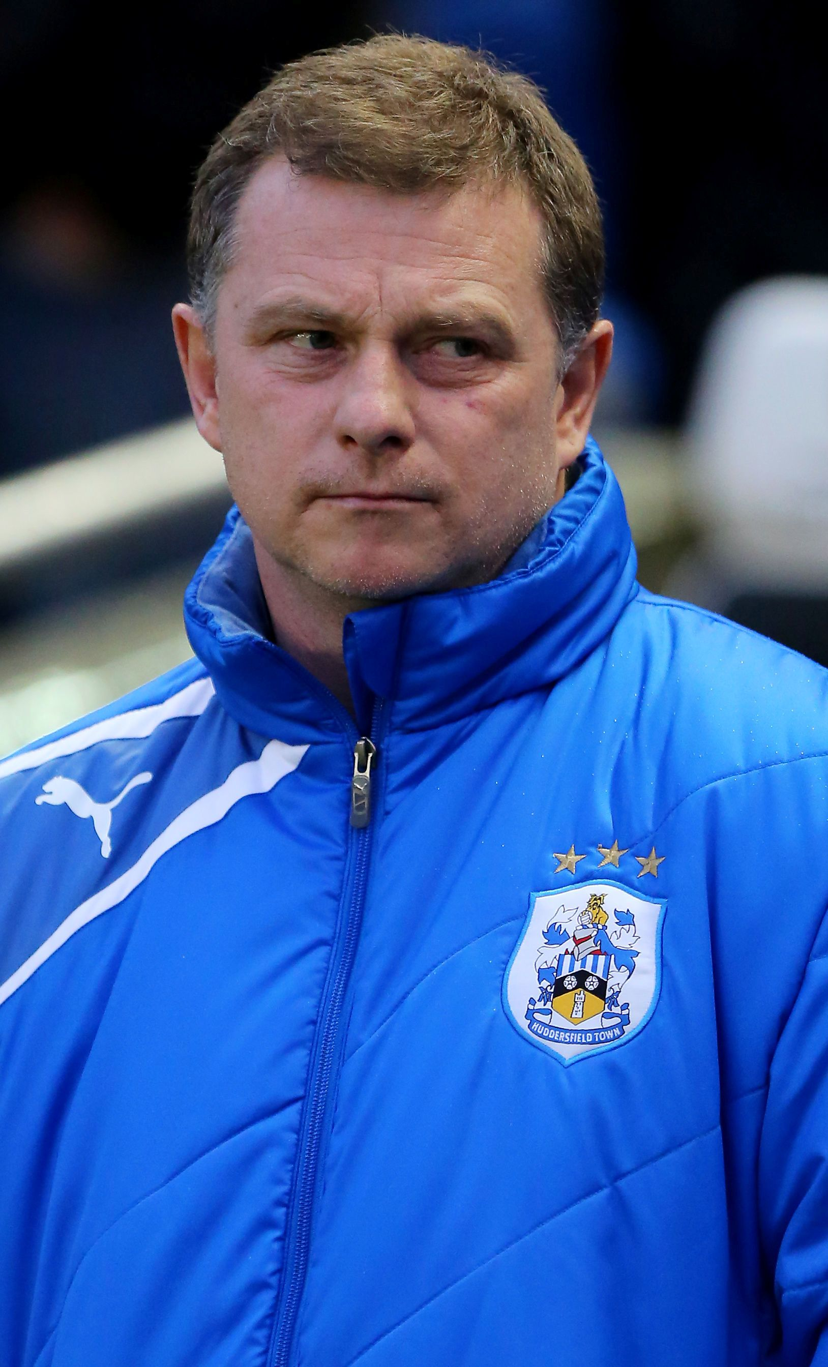Huddersfield boss Mark Robins has made three enforced team changes