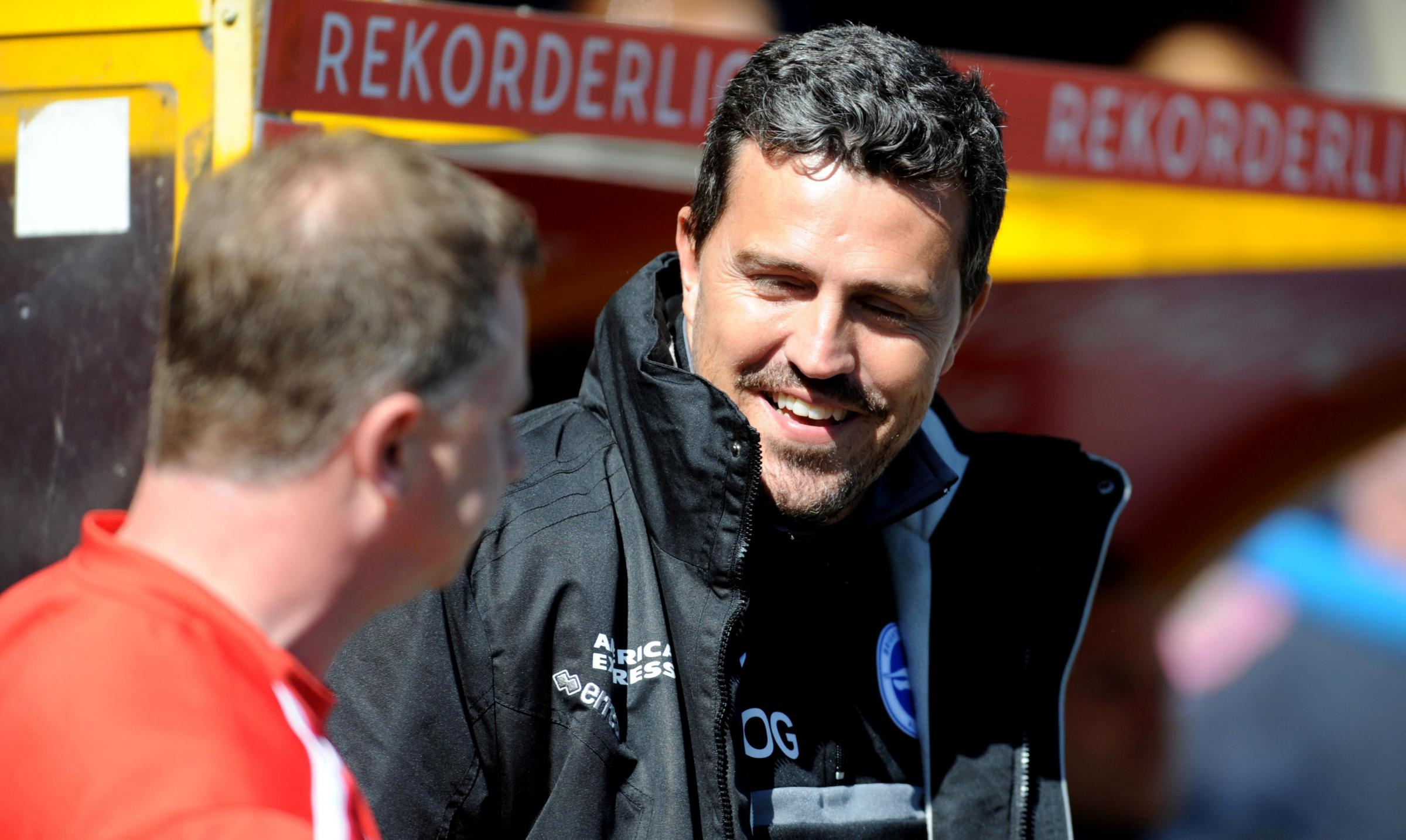 Oscar Garcia (right) wants his players to enjoy the play-off fight