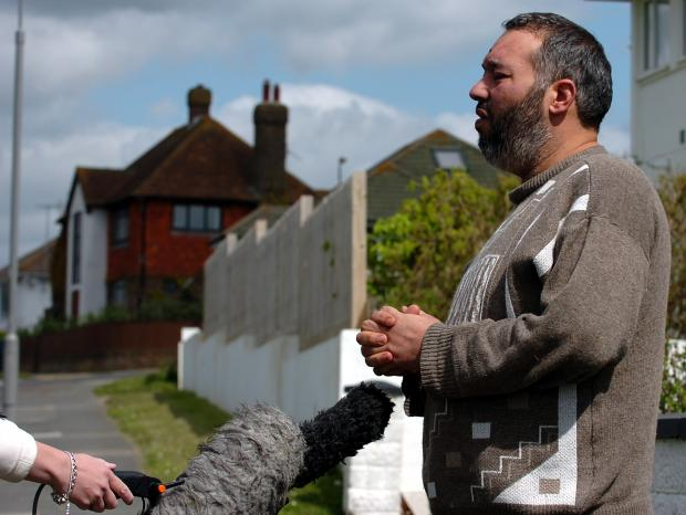 Abubaker Deghayes speaking outside his home last month