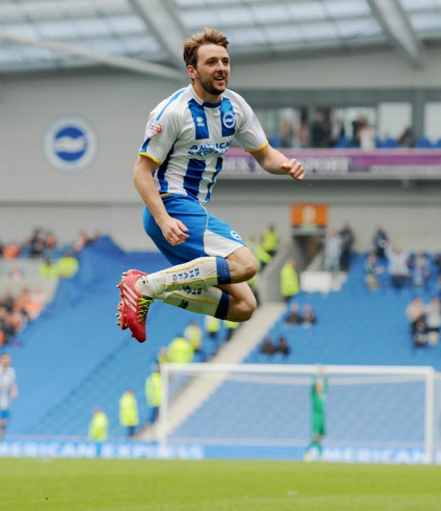 The Argus: Dale Stephens leaps into the air with joy after scoring (photo Simon Dack)