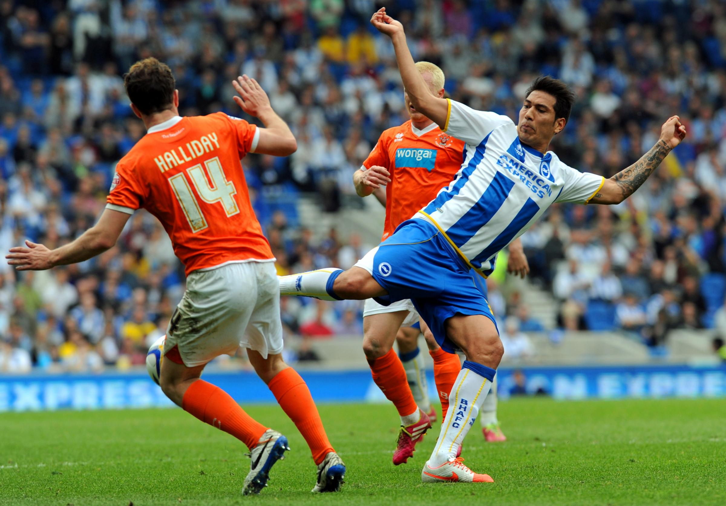 Leo Ulloa battles with the Blackpool defence today