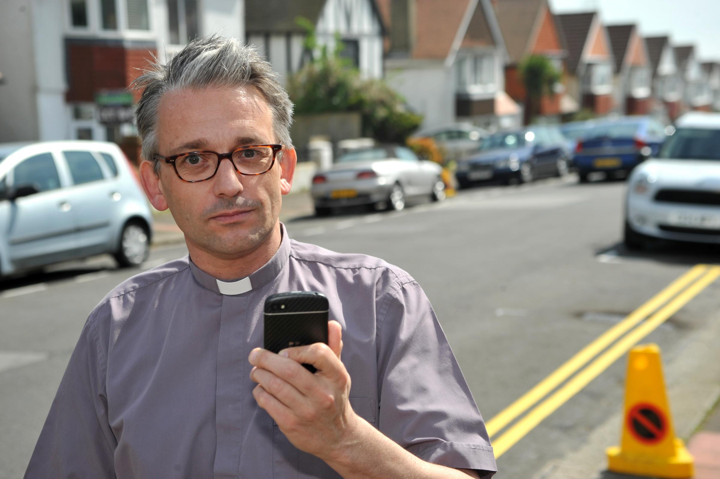 Vicar refuses to tow the line in parking row