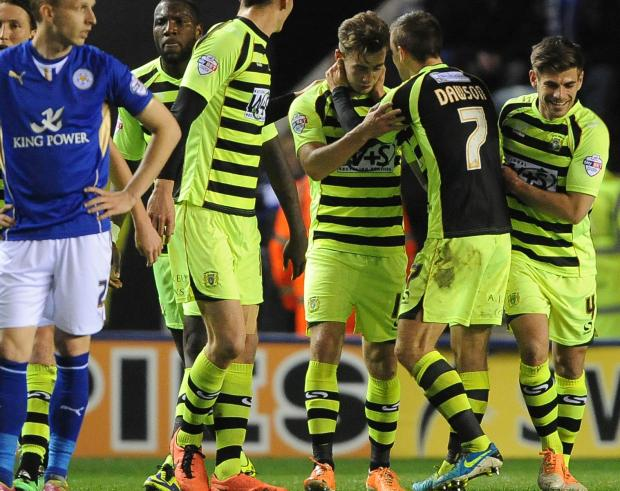 The Argus: Joe Ralls is congratulated on his goal for Yeovil at Leicester