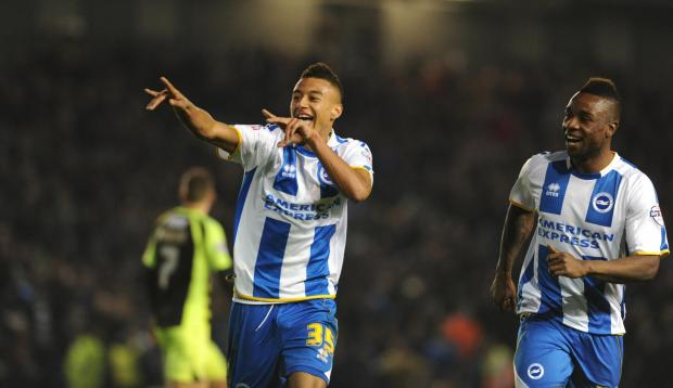 The Argus: Jesse Lingard and Kazenga LuaLua celebrate the second goal last night. Picture by Simon Dack