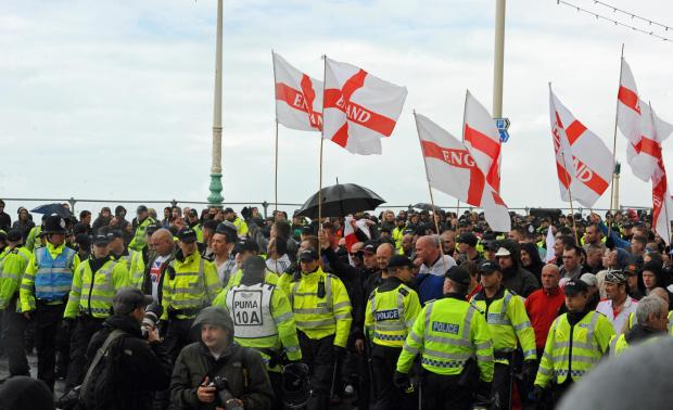 The Argus: Female police officers surrounded and assaulted after March for England