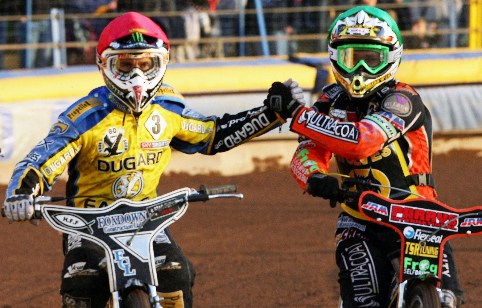 Tai Woffinden shakes hands with Lewis Bridger on a visit to Arlington in 2009