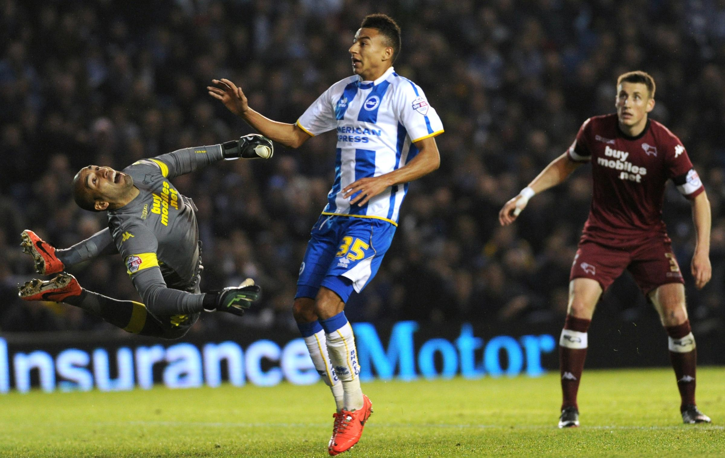 Jesse Lingard watches Lee Grant push Leo Ulloa's shot on to the bar as Albion push for an equaliser
