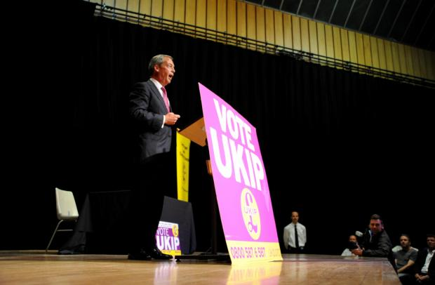 Nigel Farage speaking in a disrupted meeting in Hove in June last year