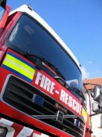 Man rescued from burning flat
