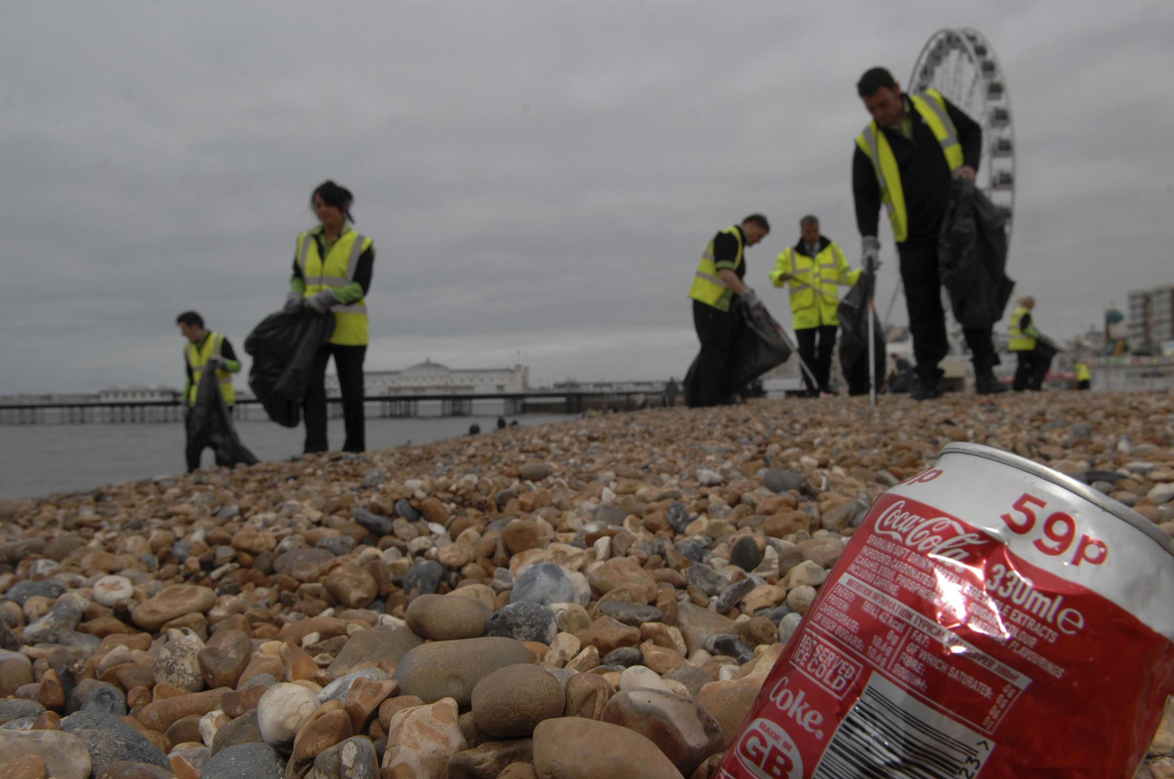 Volunteers and firms join together for clean-up