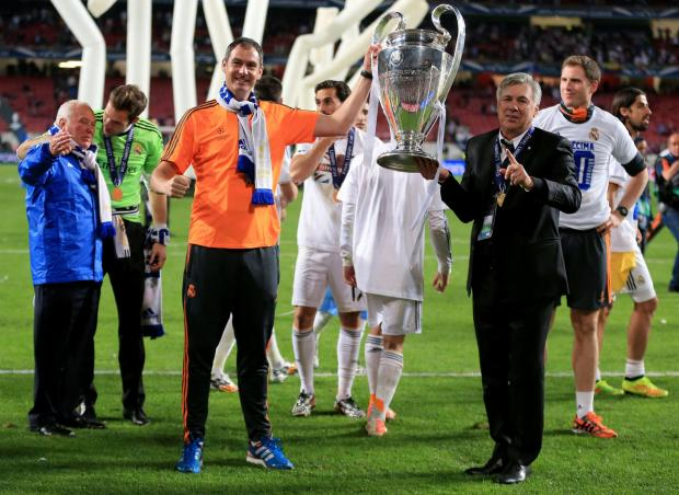 Paul Clement lifts the Champions League trophy with Carlo Ancelotti last night