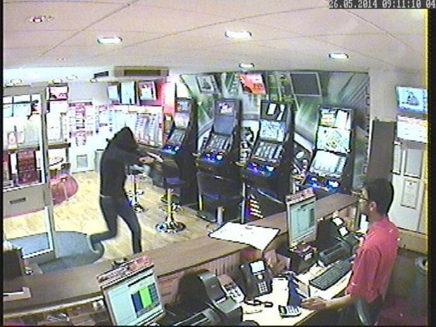 Police hunting knife man after Brighton betting shop raid