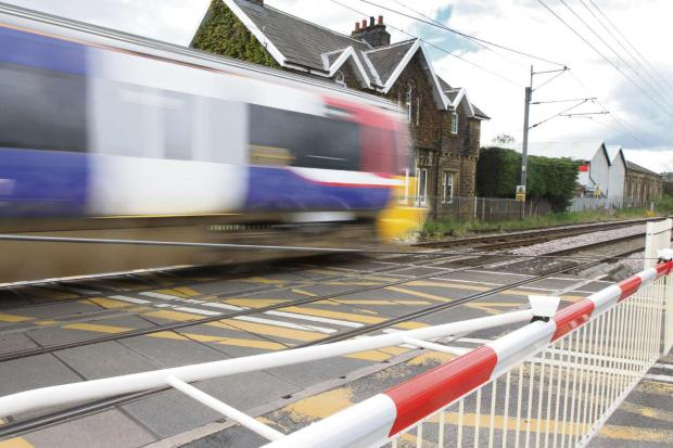 Level crossing barrier stuck down