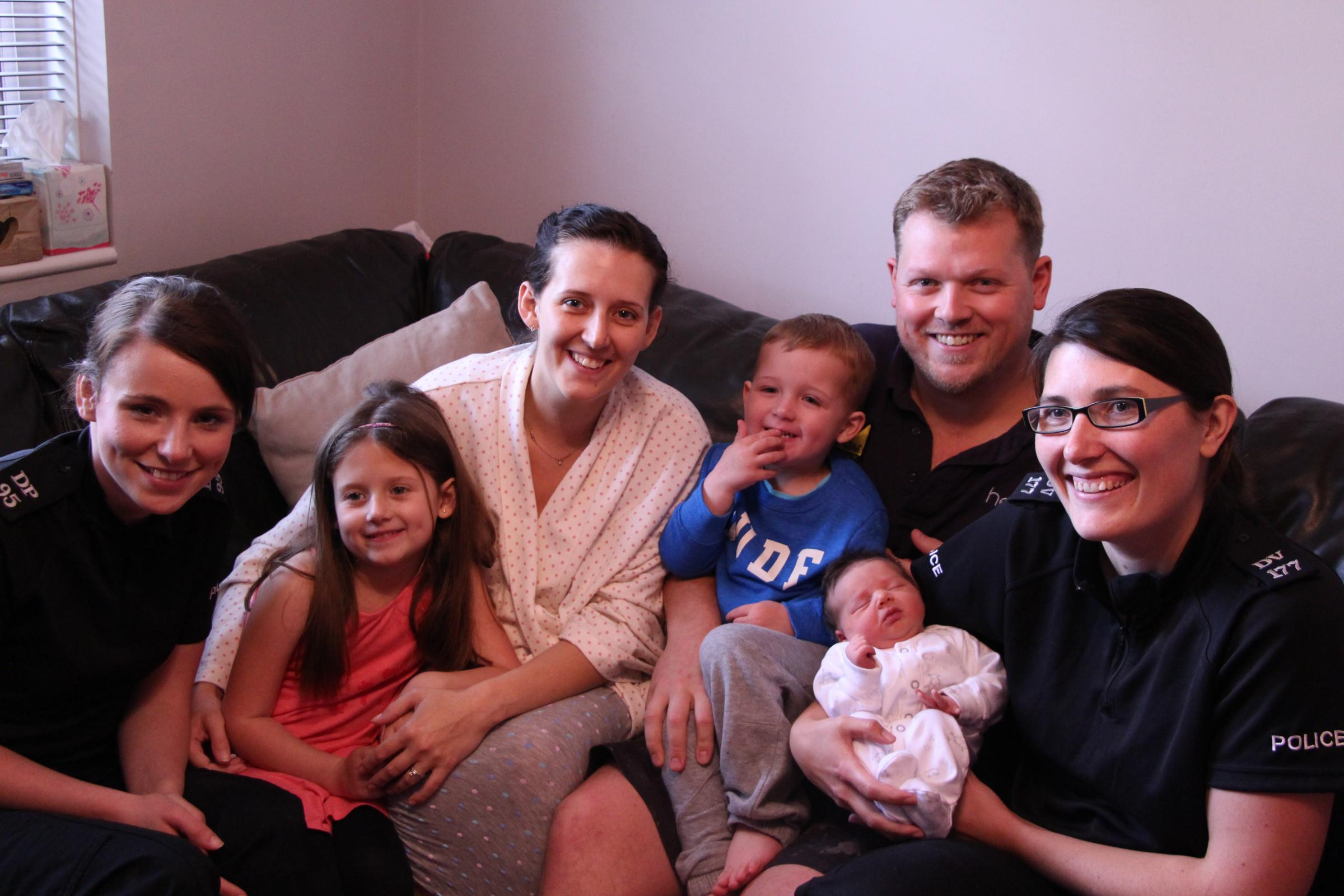 Officers Roisin Vafaee and Jenny Pietersen with the Marcantonio family including newborn baby Thea.