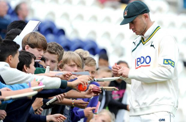 Alex Hales signs autographs earlier in the day. Picture by Liz Finlayson