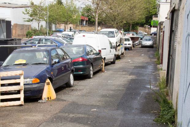 Traders' cars clamped on 'private road'