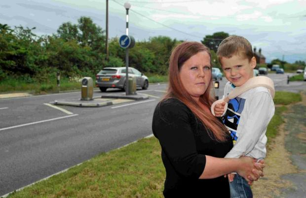 Kathleen Hannam and son Alfie who was hit by a car while crossing the A22