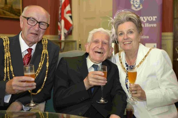 Bernard Jordan, who recently absconded from his care home for the D-day celebrations, at the Mayor's Parlour at Brighton Town Hall with Brian and Norah Fitch