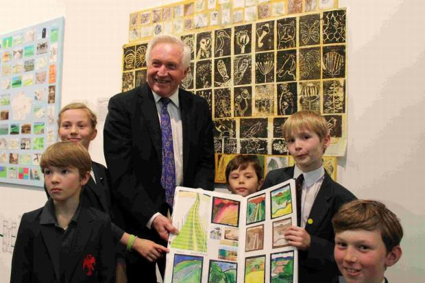 TV star David Dimbleby is wowed by Eastbourne pupils' exhibition