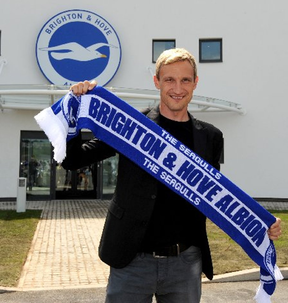 Sami Hyypia shows off his new colours at Albion's training ground today