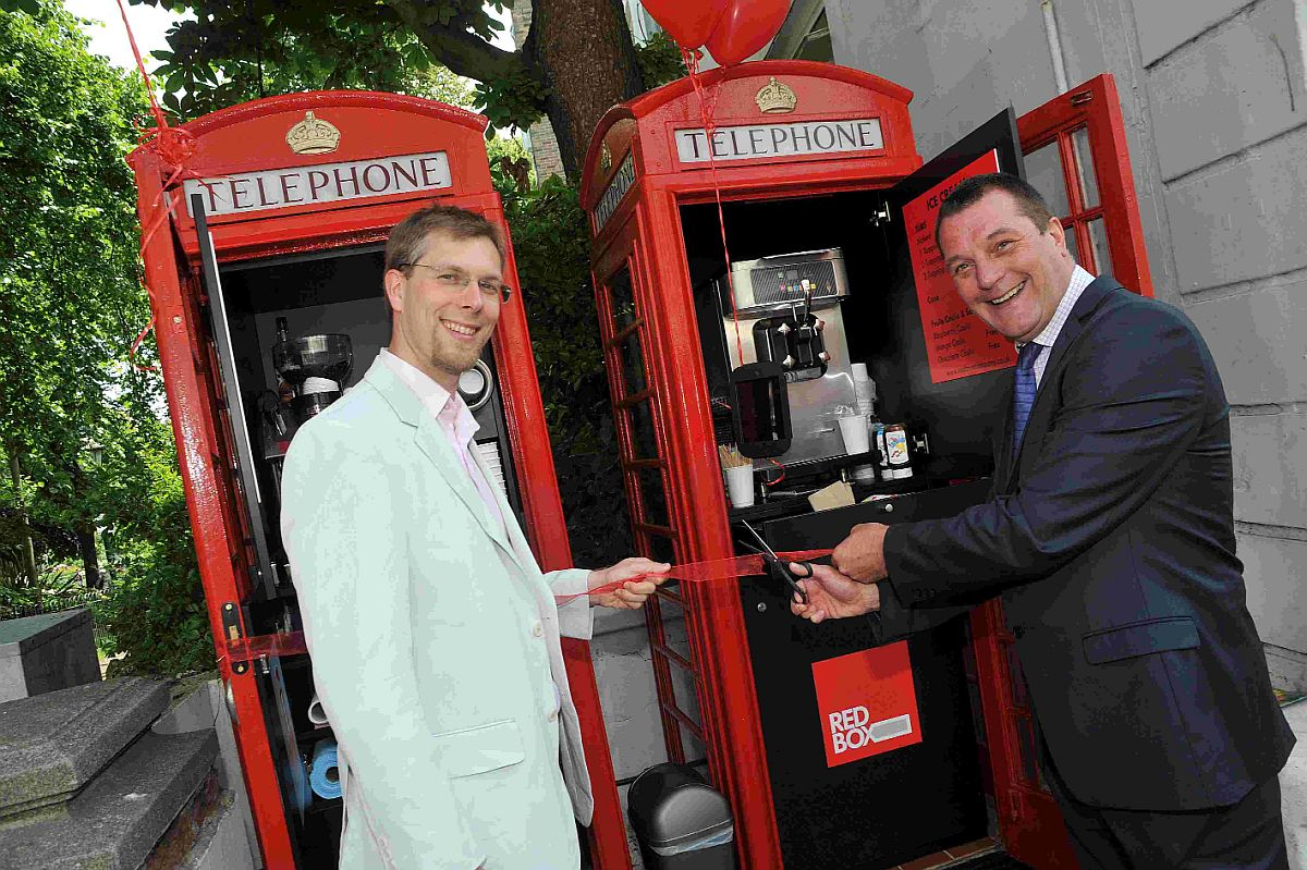 Jason Kitcat, leader of Brighton and Hove City Council, and Mark Johnson of BT check out the new look kiosks
