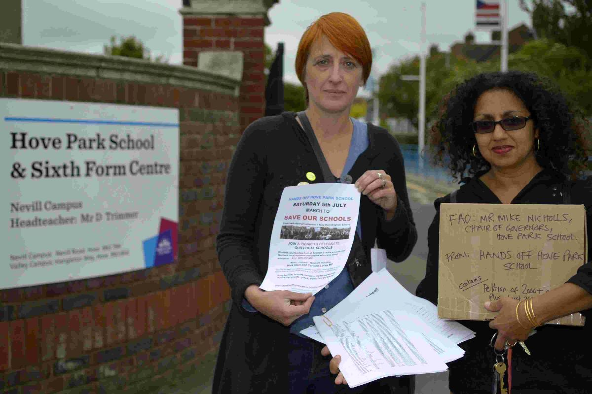 Natasha Steel, left, and Sharon Duggal with the petition