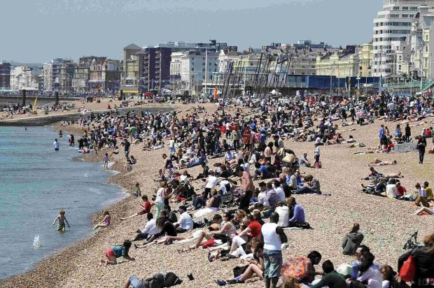 Crowds enjoy the hot weather on Brighton beach