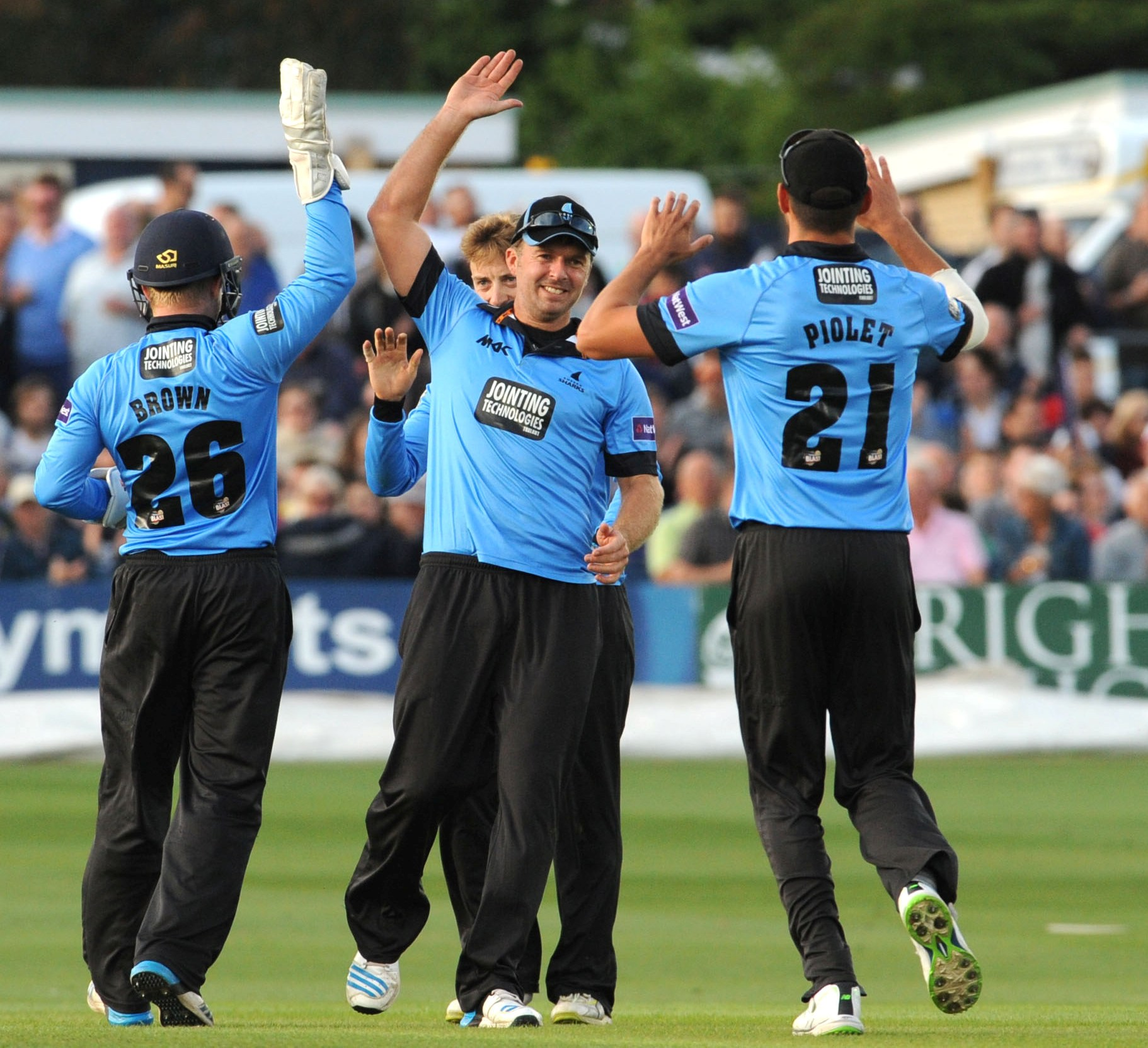 Sussex celebrate a wicket tonight. Pic by Simon Dack