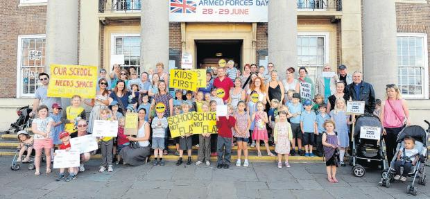 Parents pleased as school flats plan is put on hold