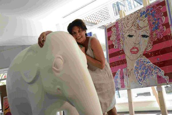Artist Louise Dear pictured at her pop-up shop in Brighton Square with Tinkle, an elephant she painted to raise money for a charity called Elephant Family