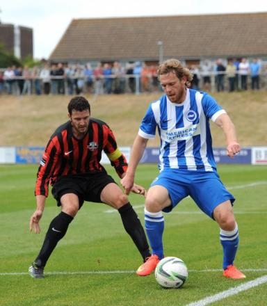 Craig Mackail-Smith shields the ball during last Saturday's friendly at Lewes