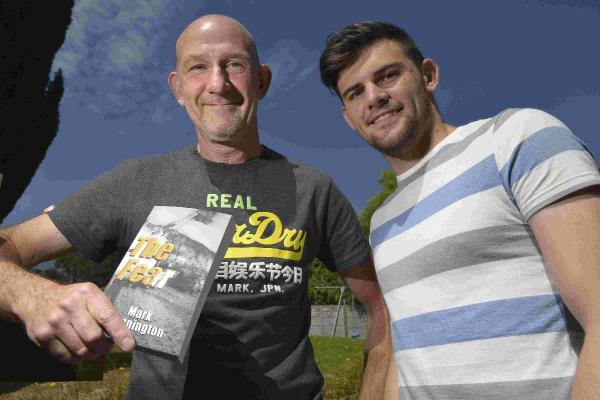 Mark Cunnington with his son Matthew, who suffered a cardiac arrest at the age of 12
