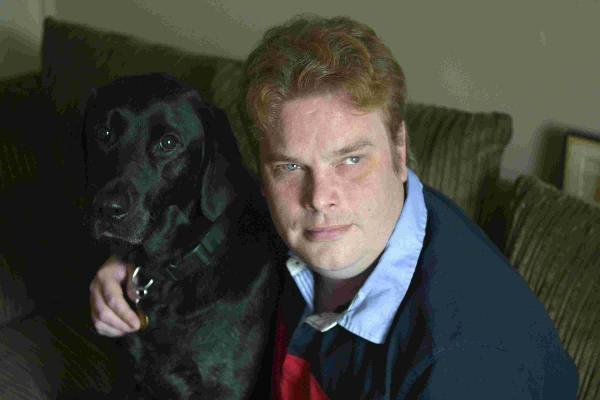 Daniel Walker, with his dog Pebble, was told he was overqualified for an unpaid work placement