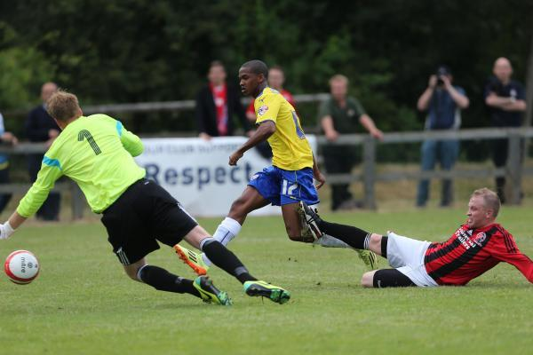 Lewis Young scoring for Crawley against Billingshurst last Friday. Picture by James Boardman