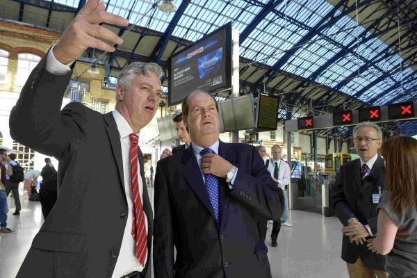 Trains Minister Stephen Hammond with Simon Kirby MP (left) at Brighton station as part of a campaign for improvements to the London-Brighton service