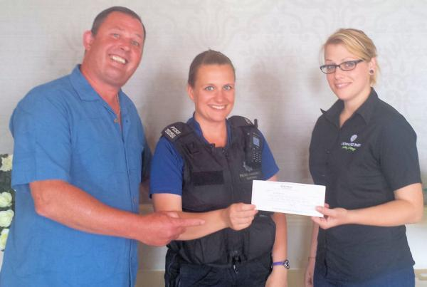Police donate money from confiscated goods to charity