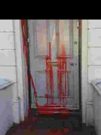Vandals throw paint mixed with excrement over door